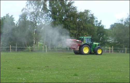 Tractor spreading lime